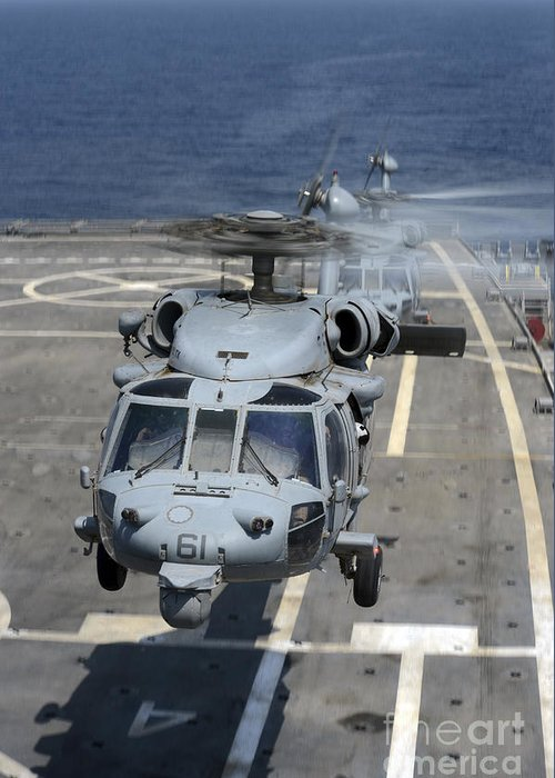 Military Greeting Card featuring the photograph Two Mh-60s Sea Hawk Helicopters Take by Stocktrek Images