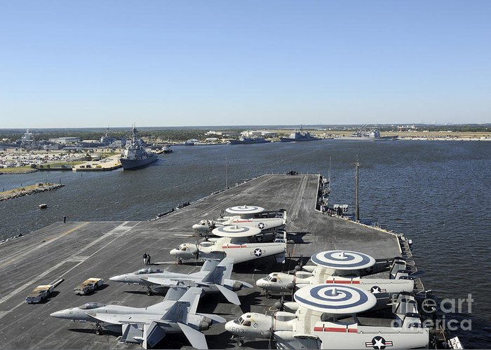 Military Greeting Card featuring the photograph Uss Enterprise Arrives At Naval Station by Stocktrek Images