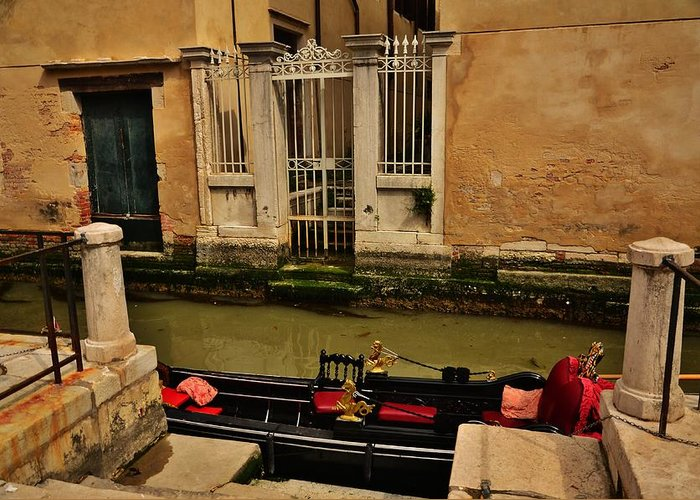 Architecture Beautiful Walls And Doors On The Venetian Canals ..awaiting Gondolas...great Colour Contrast With The Red Cushions And Ochre Crumbling Walls ... Greeting Card featuring the photograph Venice Canal Gondola Awaits by Diana Shuter