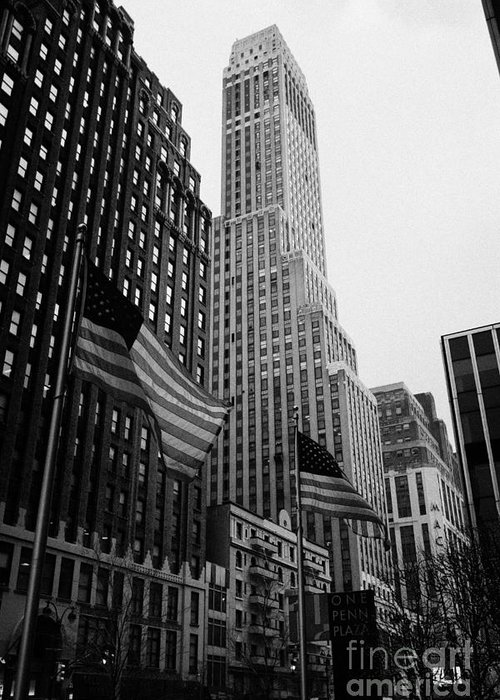 Usa Greeting Card featuring the photograph view of pennsylvania bldg nelson tower and US flags flying on 34th street from 1 penn plaza new york by Joe Fox