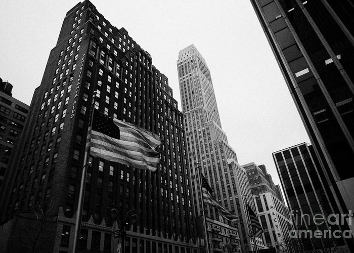 Usa Greeting Card featuring the photograph view of pennsylvania bldg nelson tower and US flags flying on 34th street from 1 penn plaza nyc by Joe Fox