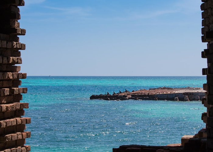 Beach Greeting Card featuring the photograph View Through The Walls Of Fort Jefferson by John M Bailey