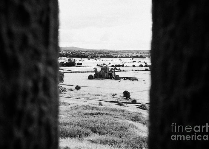 Ireland Greeting Card featuring the photograph viewpoint looking out through stone fortifications towards hore abbey from the Rock of Cashe by Joe Fox