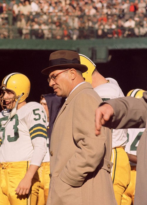 Marvin Newman Greeting Card featuring the photograph Vince Lombardi In Trench Coat by Retro Images Archive