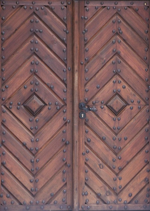 Material Greeting Card featuring the photograph Vintage Wooden Brown Door Close-up by Bogdan Khmelnytskyi