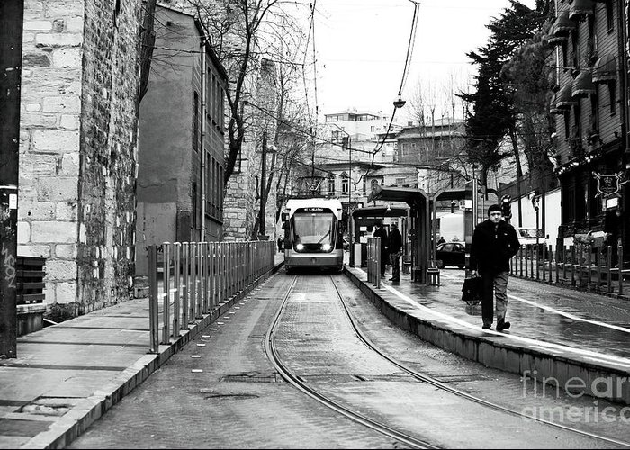 Waiting For The Tram In Istanbul Greeting Card featuring the photograph Waiting For The Tram In Istanbul by John Rizzuto