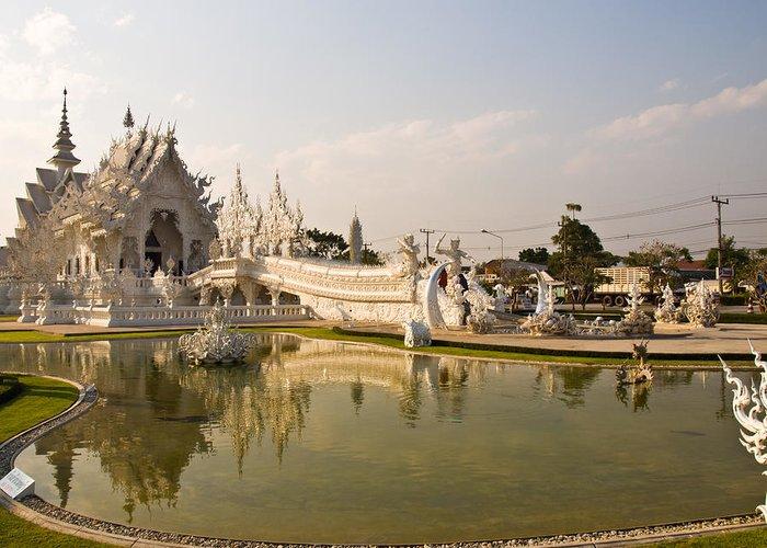 Chiang Rai Greeting Card featuring the photograph Wat Rong Khun And Its Reflection In Chiang Rai Thailand by Ammar Mas-oo-di