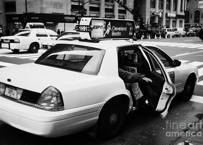 Usa Greeting Card featuring the photograph white caucasian passenger closes rear door of yellow cab on taxi rank at crosswalk on 7th Avenue by Joe Fox