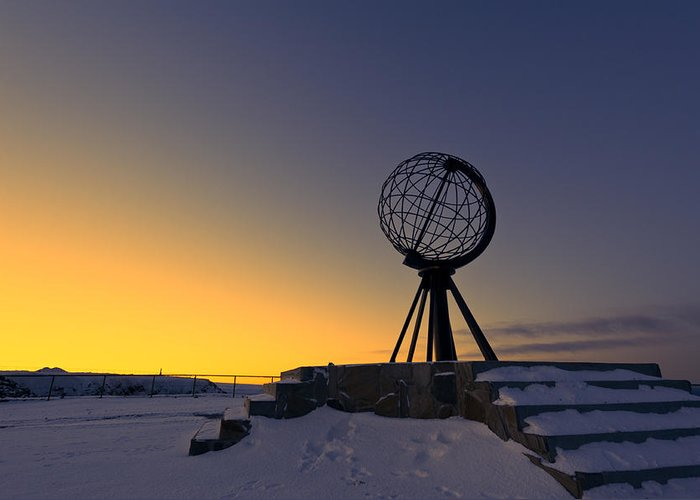 Longitude; Latitude; Arctic; Cape; Concept; Europe; European; Evening; Famous; Globe; Monument; Nature; Nordkapp; North; Northern; Northland; Norway; Norwegian; Point; Postcard; Scandinavia; Sign; Silhouette; Sky; Sphere; Statue; Sun; Sunset; Symbol; Symbolic; Tourism; Travel; View; World; Northernmost Point; Dawn; Dusk; Golden Greeting Card featuring the photograph Winter Beyond The Arctic Circle by Ulrich Schade
