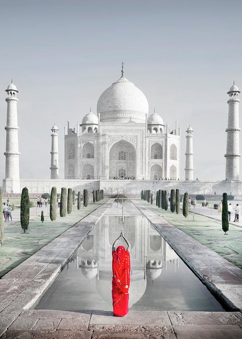 Tranquility Greeting Card featuring the photograph Woman In Red Sari Praying At Taj Mahal by Grant Faint