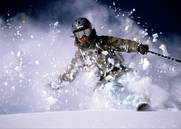 Action Greeting Card featuring the photograph Woman Skiing Powder In The Wasatch by Scott Markewitz