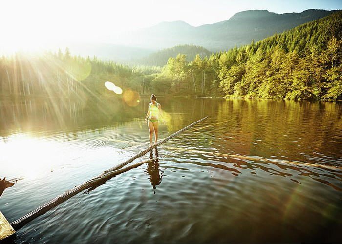 Pets Greeting Card featuring the photograph Woman Walking On Log In Alpine Lake by Thomas Barwick