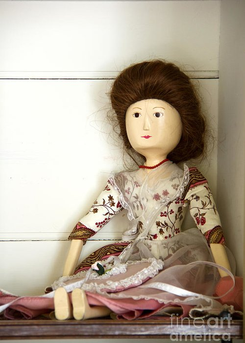 Doll; Toy; Wood; Wooden; Painted; Hair; Gentry; Colonial; Caucasian; Sit; Sitting; Shelf; Pretty; Brunette; Beautiful; Feminine; Dress; Necklace; Stare; Staring; Tiny; Female; Woman; Lady; Store; Toy Room Greeting Card featuring the photograph Wooden Doll by Margie Hurwich