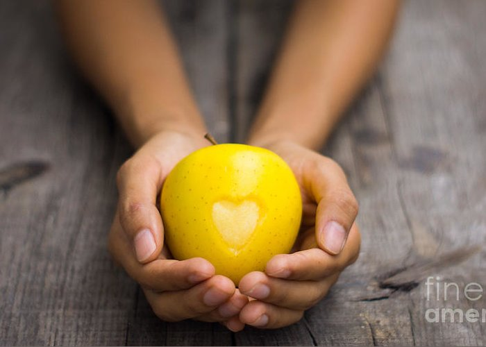 Apple Greeting Card featuring the photograph Yellow Apple With Engraved Heart by Aged Pixel
