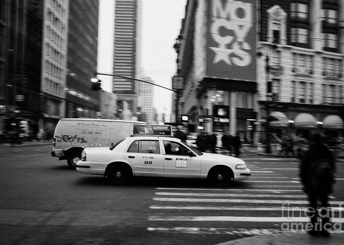 Usa Greeting Card featuring the photograph yellow cab taxi blurs past pedestrian waiting at crosswalk on Broadway outside macys new york usa by Joe Fox