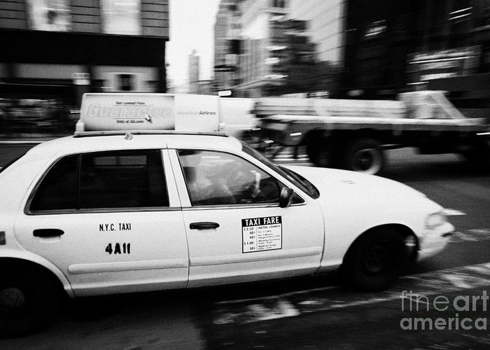 Usa Greeting Card featuring the photograph Yellow Cab With Advertising Hoarding Blurring Past Crosswalk And Pedestrians New York City Usa by Joe Fox