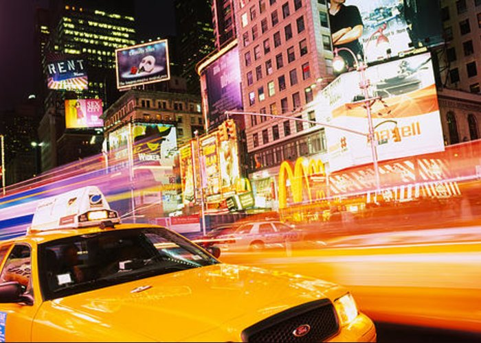 Photography Greeting Card featuring the photograph Yellow Taxi On The Road, Times Square by Panoramic Images