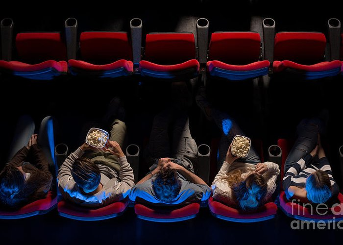 Entertain Greeting Card featuring the photograph Young People Sitting At The Cinema by Stock-asso
