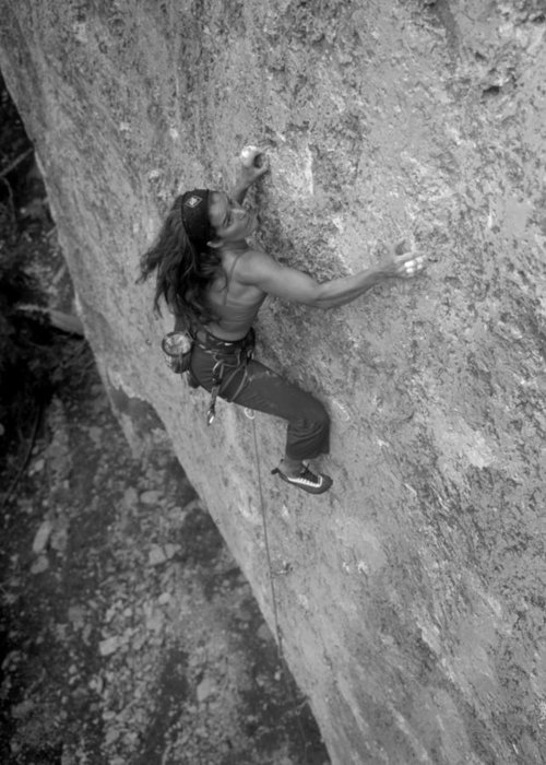 One Person Greeting Card featuring the photograph A Caucasian Women Rock Climbing by Bobby Model