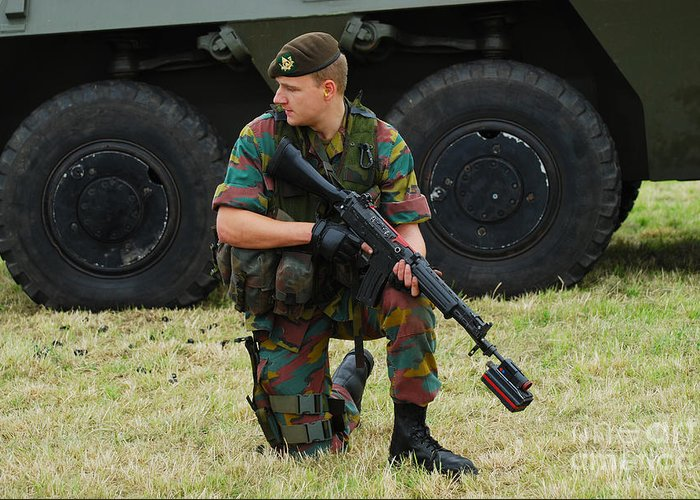 5.56mm Greeting Card featuring the photograph A Soldier Of An Infantry Unit by Luc De Jaeger