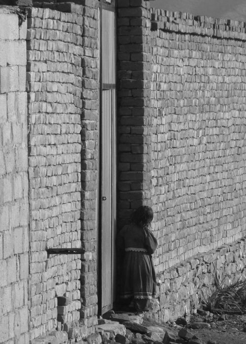 Bricks Greeting Card featuring the photograph Afghan Girl In Doorway by Brittany Roth