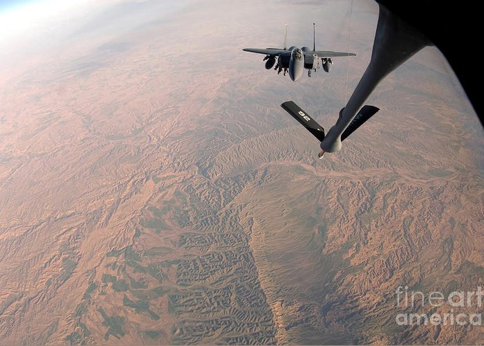 Color Image Greeting Card featuring the photograph An F-15e Strike Eagle Is Refueled by Stocktrek Images