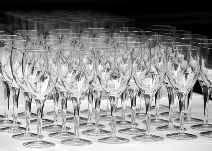 Kitchen; Dinner; Breakfast; Glasses; Clear; Many; Lots; Glass; Crystal; Crystal Glass; Crystal Glasses; Empty; Empty Glass; Empty Glasses; Black And White; Black & White; Table; Banquet; On A Table; On The Table; White; Black; Table Cloth; Light; Shadows; Abstract; In A Row; Row; Rows; Rows Of Glasses; Geometry; Svetlana Sewell Greeting Card featuring the photograph Banquet Glasses by Svetlana Sewell