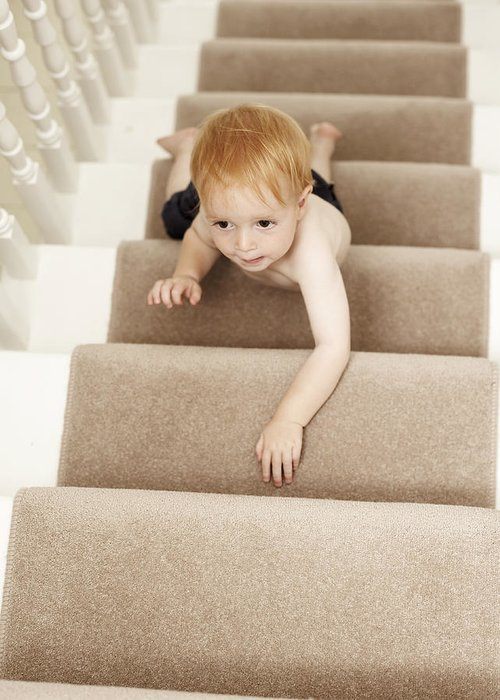 Human Greeting Card featuring the photograph Boy Climbing Stairs by Ian Boddy