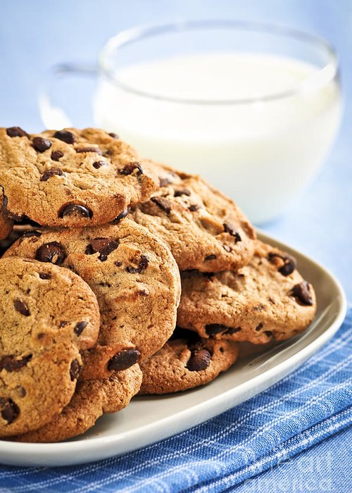 Cookies Greeting Card featuring the photograph Chocolate Chip Cookies And Milk by Elena Elisseeva