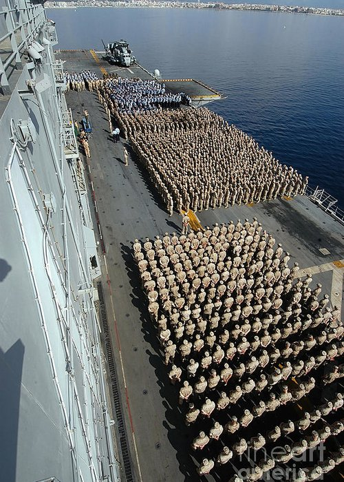 Color Image Greeting Card featuring the photograph Crew Aboard The Amphibious Assault Ship by Stocktrek Images