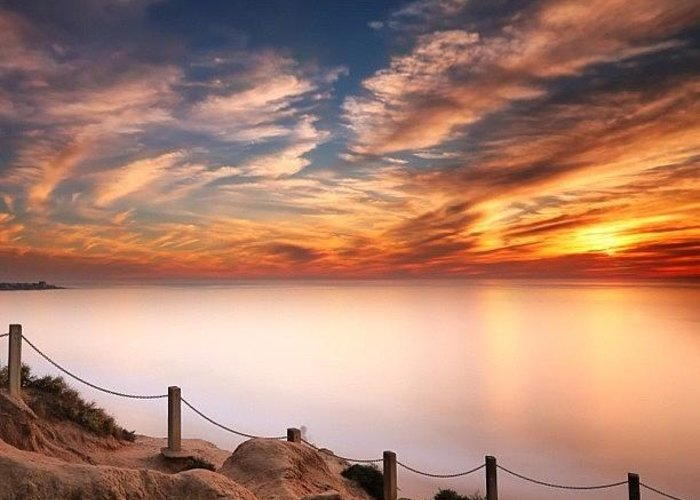 Greeting Card featuring the photograph Long Exposure Of Last Night's Sunset by Larry Marshall