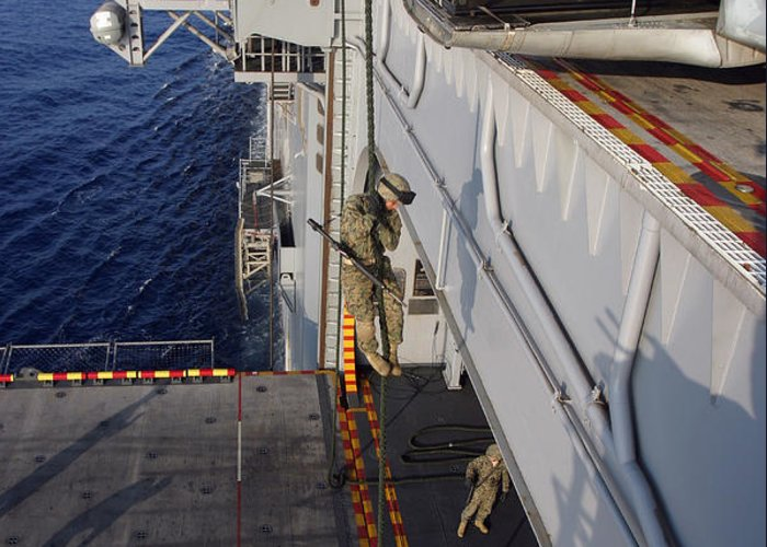 Aircraft Greeting Card featuring the photograph Marines And Sailors Fast-rope by Stocktrek Images