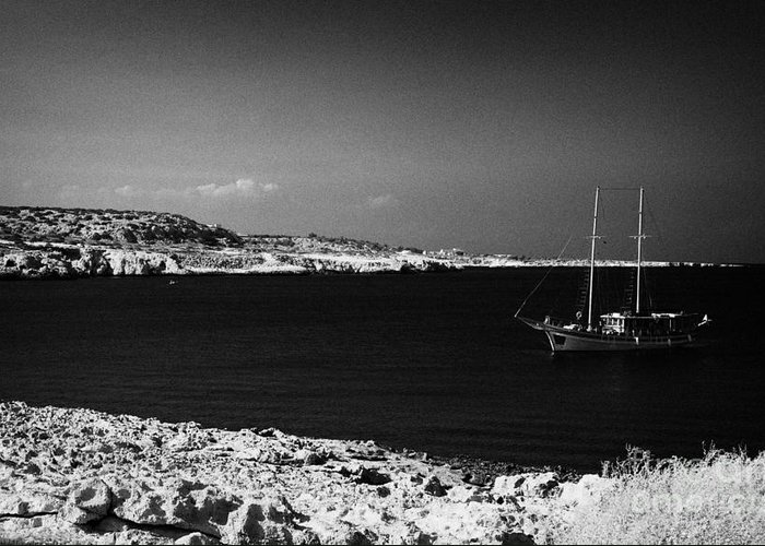 Sailing Greeting Card featuring the photograph Sailing Boat Moored In A Quiet Bay Near Cape Gkreko Greco Republic Of Cyprus by Joe Fox