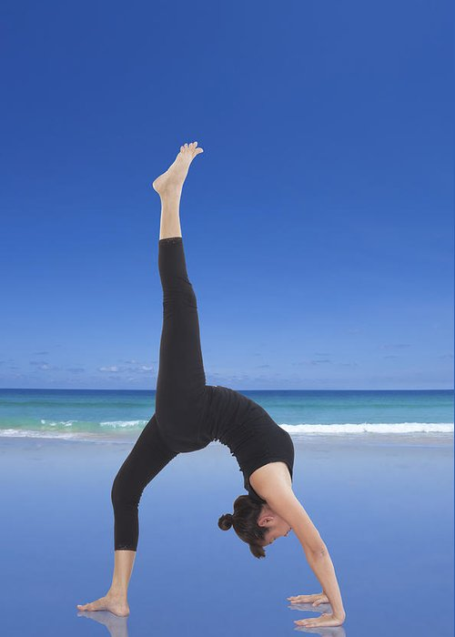 Action Greeting Card featuring the photograph Woman Doing Yoga On The Beach by Setsiri Silapasuwanchai