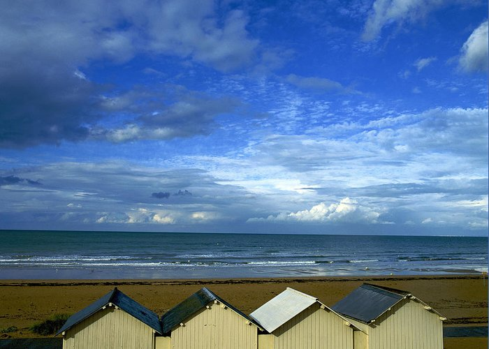 Wooden Greeting Card featuring the photograph Beach Huts Under A Stormy Sky In Normandy by Bernard Jaubert