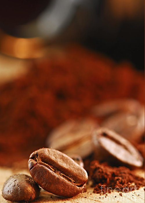 Coffee Greeting Card featuring the photograph Coffee Beans And Ground Coffee by Elena Elisseeva