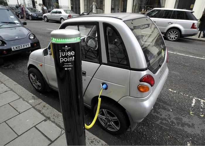 Reva Greeting Card featuring the photograph Recharging An Electric Car by Martin Bond
