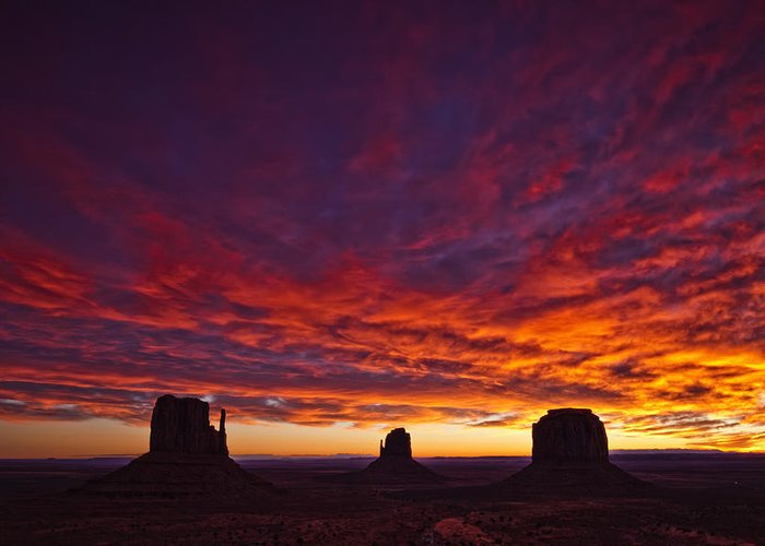 Light Greeting Card featuring the photograph Sunrise Over Monument Valley, Arizona by Robert Postma