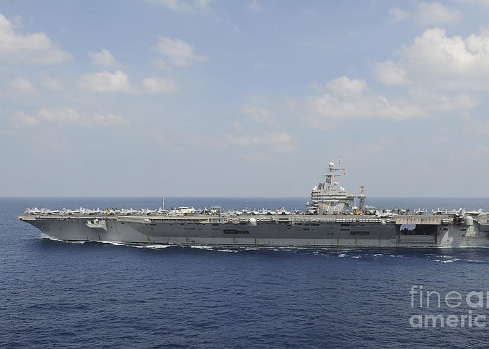 Blue Greeting Card featuring the photograph Uss Abraham Lincoln Transits The Indian by Stocktrek Images