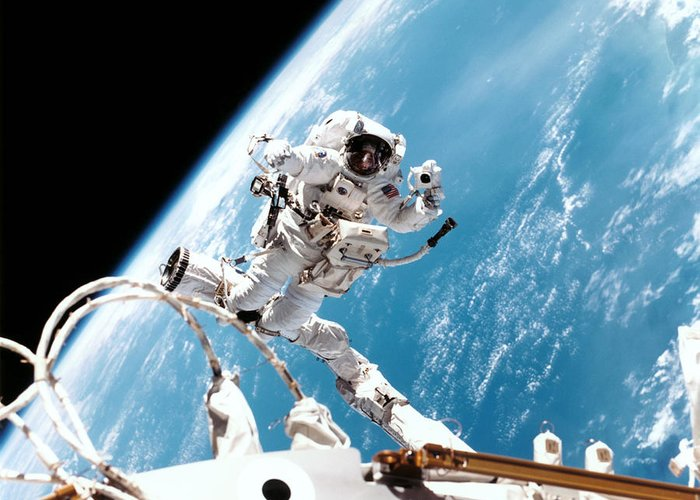 Spacesuit Greeting Card featuring the photograph Iss Space Walk by Nasa