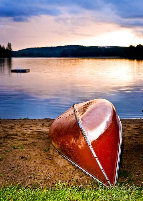 Canoe Greeting Card featuring the photograph Lake Sunset With Canoe On Beach by Elena Elisseeva