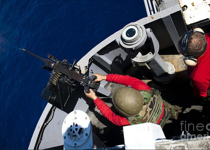 Overhead View Greeting Card featuring the photograph A Sailor Fires A .50-caliber Machine by Stocktrek Images