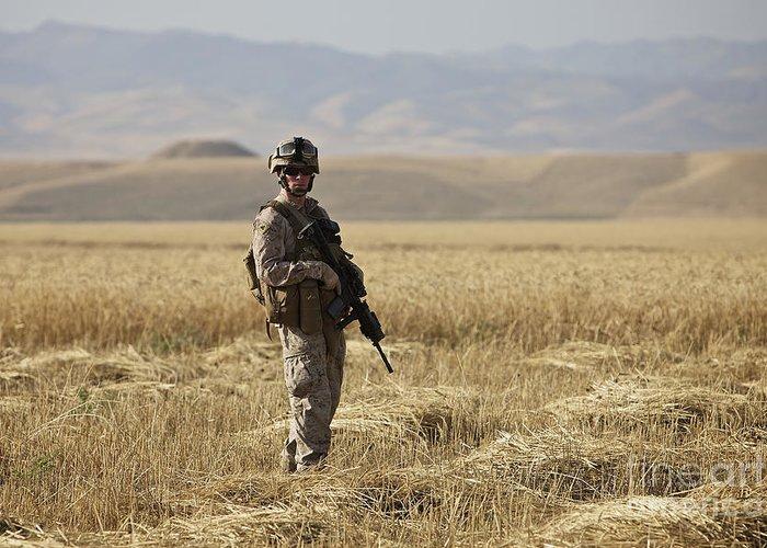 Patrol Greeting Card featuring the photograph U.s. Marine Patrols A Wadi Near Kunduz by Terry Moore