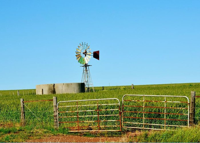 Water Pump; Windmill; Summer; Warm; Wind; Sky; Grass; South Africa; Landscape; Nature; Rural; Background; Decorative; Green; Meadow; Tank; Concrete; Swartland; Blue; Metal; Wheel; Greeting Card featuring the photograph Windmill Water Pump by Werner Lehmann