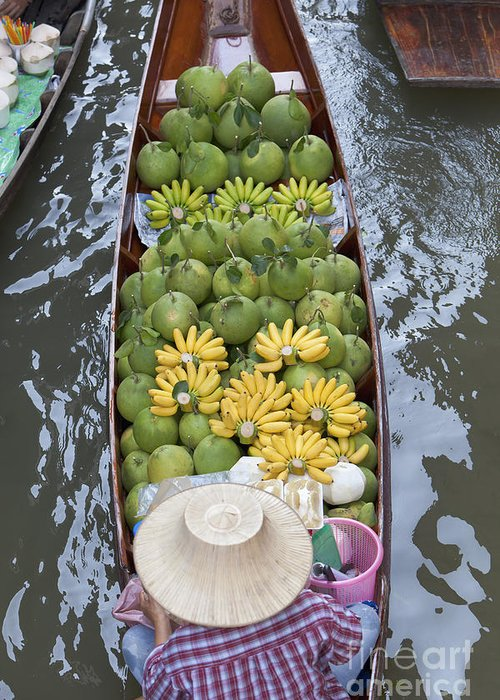 Asia Greeting Card featuring the photograph A Boat Laden With Fruit At The Damnoen Saduak Floating Market In Thailand by Roberto Morgenthaler