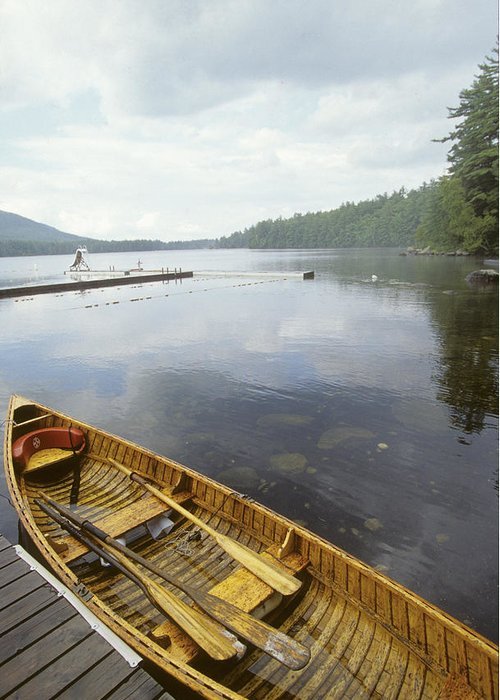 No People Greeting Card featuring the photograph A Canoe Floats Next To A Dock by Skip Brown