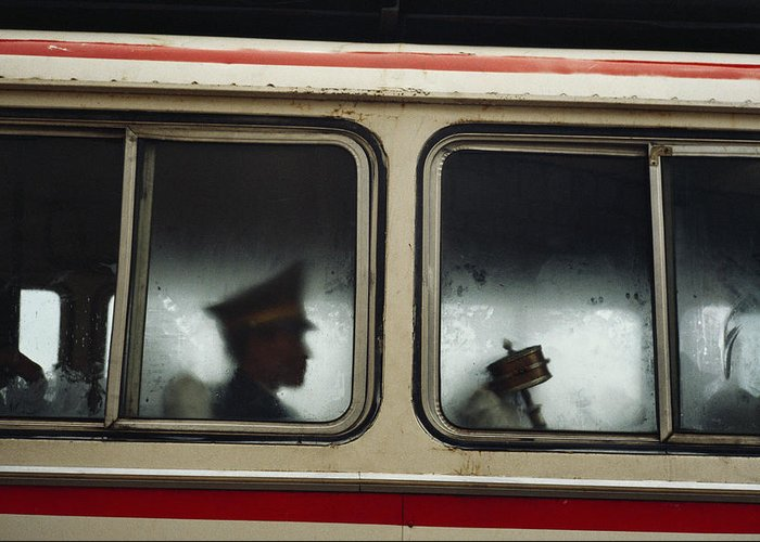Armed Forces Greeting Card featuring the photograph A Chinese Pla Soldier Sits On A Bus by Justin Guariglia