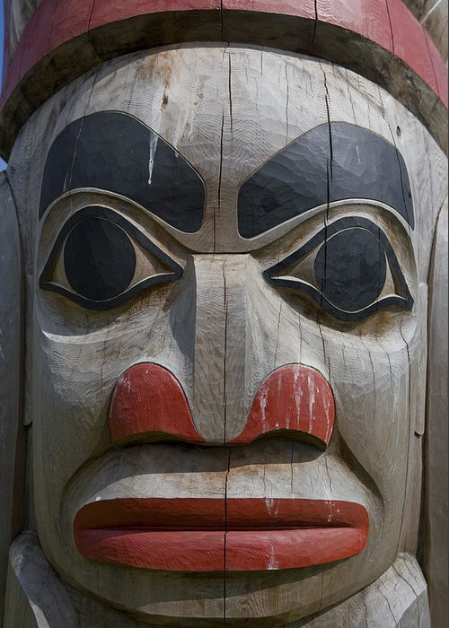 Queen Charlotte Islands Greeting Card featuring the photograph A Close View Of The Carvings Of A Totem by Taylor S. Kennedy