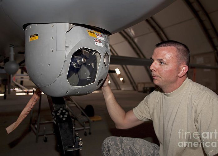 Gimbal Greeting Card featuring the photograph A Crew Chief Works On Mq-1 Predators by HIGH-G Productions