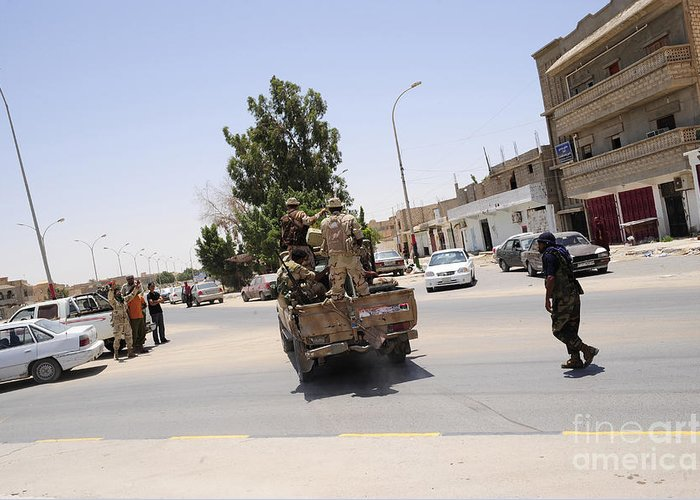 Libya Greeting Card featuring the photograph A Free Libyan Army Pickup Truck by Andrew Chittock